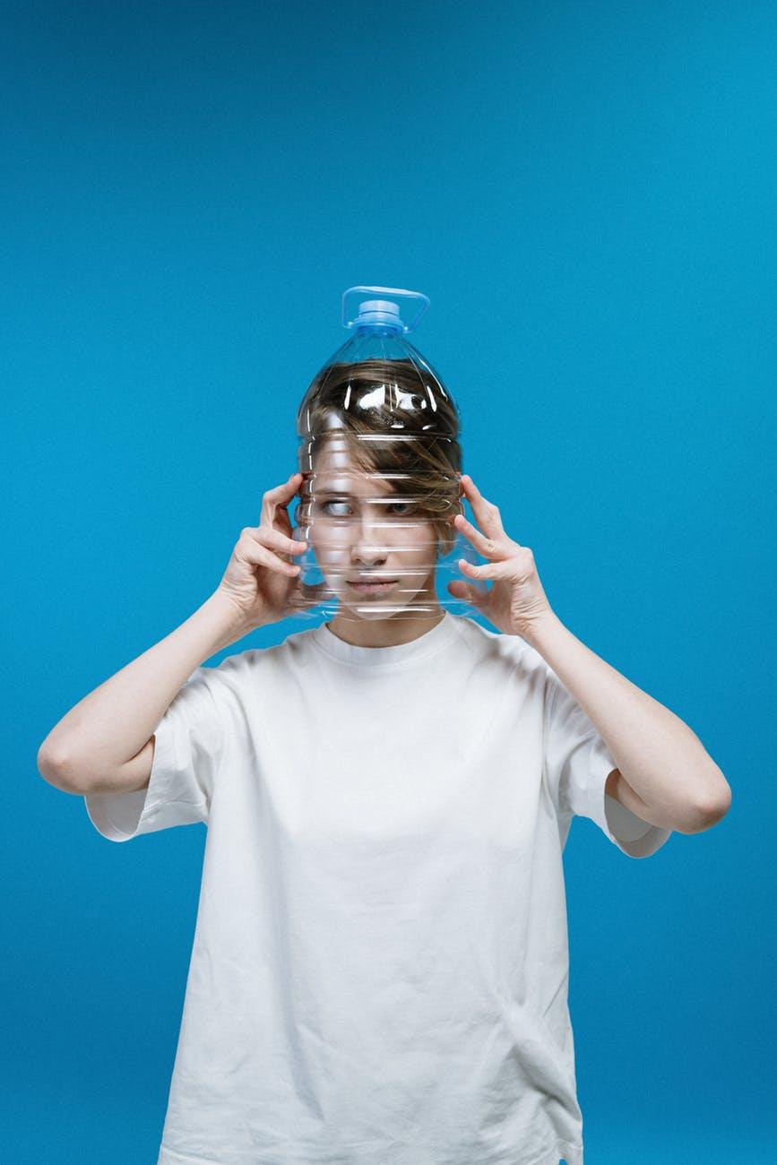 woman wearing plastic bottle on head